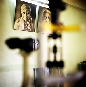 Two portraits hang on a wall next to a vision test device in Aravind Eye Hospital. This series of photos showcases stories of people from different countries living with chronic diseases and common underlying risks. In a world where more and more people are dying as a result of chronic diseases, and many more millions are disabled, these stories aim to demonstrate the strong and personal impact of chronic diseases on individuals and their families.
