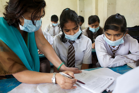 Illustration about influenza in Nepal and related topics.  Staff and students wear face masks at the Tika Vidyashram government school in Kathmandu.