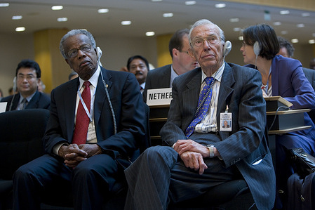 Sixty-second World Health Assembly, Geneva, Switzerland, 18 - 22 May 2009    Former WHO Director-General, Dr Halfdan Mahler (right) and  former PAHO Director, Sir Georges Alleyne,        Title of the Officials and WHO staff reflects their respective positions at the time the photo was taken.