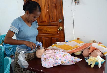 Health Alliance International (HAI) training for midwives in Timor-Leste.  Nurse Maria Lucia practices resuscitation during Health Alliance International (HAI) training.