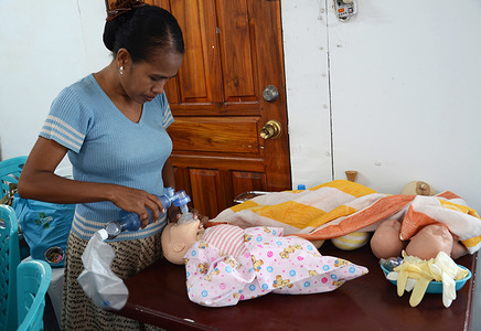 Health Alliance International (HAI) training for midwives in Timor-Leste.  Nurse Maria Lucia practices resuscitation during Health Alliance International (HAI) training.