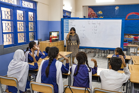 Karachi, Pakistan - 3 May, 2019: Sign language classes for deaf kids as part of the rehabilitation and training process at the Deaf Reach School and College in Karachi, Pakistan.