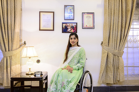 Rawalpindi, Pakistan - 5 May, 2019: Dr Sana Hafeez and her family home. Few years ago she had an accident at a friend's wedding and got a severe spinal cord injury that has affected the mobility of her legs. Three months after the accident she went back to the medical school and graduated. Then she got a specialization in radiology and  she is currently working half-time in a Hospital in Rawalpindi, near Islamabad.
