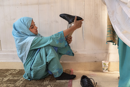 Peshawar, Pakistan - 6 May, 2019: Eman Wajid (7) during her rehabilitation and training process at the Pakistan Institute of Prosthetic and Orthotic Sciences in Peshawar (PIPOS).