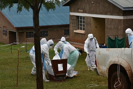 WHO's response to Marburg Virus Disease Outbreak in Eastern Uganda  A team prepares the body for safe burial.