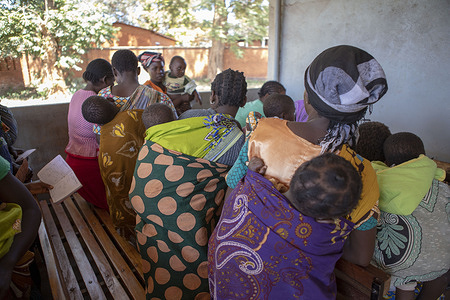 Malaria Vaccination Launch in Malawi.  Parents waiting with his babies to get vaccinated against Malaria during  the pilot programme of the Malaria vaccine in Malawi.