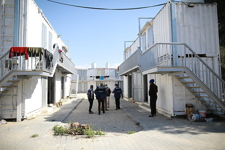 COVID-19 - Occupied Palestinian Territory  On 22 March 2020, WHO staff visit a co-located quarantine facility next to the new Rafah Crossing Field Hospital in the Gaza Strip, occupied Palestinian Territory. The quarantine facility includes 50 rooms for quarantined travellers.