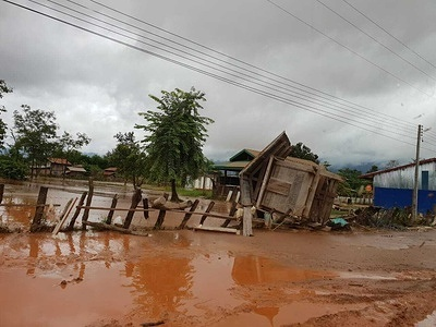 Lao PDR Dam collapse  During the evening of 23 July 2018, torrential rain overwhelmed a dam in Attapeu province in the far south of Lao People's Democratic Republic. The consequences were catastrophic. A tsunami-like wave inundated villages downstream, wiping out houses, crops and roads, injuring people and claiming lives.  From the very first hours and days following the disaster, WHO worked hand-in-hand with the Ministry of Health and partners to respond.  WHO Environmental health technical officer, Souvanaly Thammavong and WPRO logistic officer, Mr Jan-Erik Larsen support emergency response in flooding area.  Continued flooding cut off roads and left some areas accessible only by helicopter, yet WHO staff reached Attapeu within 72 hours. The Organization focused on supporting local health authorities to coordinate emergency health teams and partners, prevent disease outbreaks, ensure access to water, sanitation and hygiene (WASH), and provide mental health services.  - Read more: https://www.who.int/laos/news/feature-stories/detail/who-in-it-for-the-long-haul-as-flood-affected-families-in-attapeu-lao-pdr-rebuild-their-lives [viewed 23 October 2020].  - Title of WHO staff and officials reflects their respective position at the time the photo was taken.  Caption was not provided by the photographer. Therefore, a generic caption has been applied to this image.
