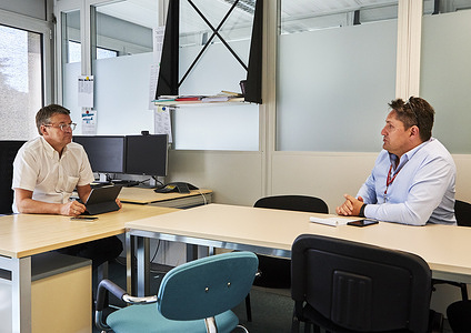 WHO headquarters: John Flanagan (left), Director Operational Support and Services and Reja Sarkis (right), Team Lead Conference and Logistics Services