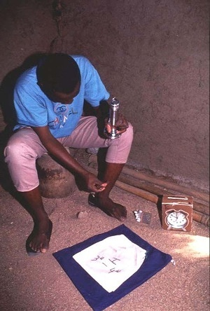 """Collecting mosquitos at night in Maroua using """"man-landing"""" methods in timed shifts. Bacillus sphaericus is being sprayed to control Culex mosquitos which cause a considerable nuisance during the wet season, although they do not carry disease in the city. The insects breed in stagnant water in latrines, drains and ditches."""