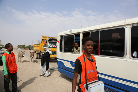 Members of a volunteer transit vaccination team check vehicles for children who need to be vaccinated against polio at Haleeye checkpoint during an immunization campaign in Hargeisa, Somalia, on 22 August 2019.