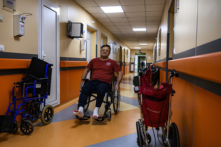 Patientin the corridor outside his room where he is recovering from an operation at the Russian Federal Rehabilitation Center in Moscow.  Diagnosis: Spinal ischemia