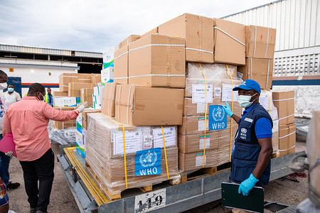 On April 18 2020, the UN Solidarity Flight lands in Brazzaville with essential medical supplies in the fight against COVID-19.   WHO Congo Procurement Assistant,  Polipos Kaloulou Bantsimba, receives the cargo with support from the Ministry of Health of Congo and the World Food Programme at the Maya Maya International Airport.