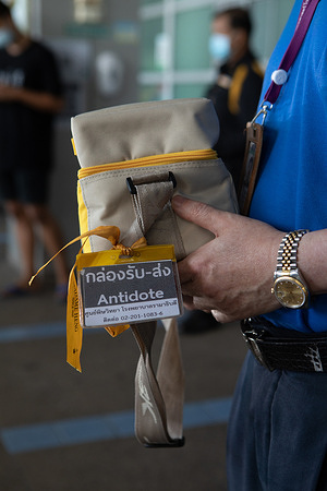 Dr Winai Wananukul, director of the Ramathibodi Poison Center, stands at the entrance of the Ramathibodi Hospital in Bangkok, Thailand, on11 January 2021, holding a poison antidote. Antidotes are examples of essential medicines that are needed to be readily available in all countries. Poisons centres play a key role in helping physicians recognize when these life saving medicines are needed as well as helping to ensure their distribution in an emergency.   Ramathibodi Poison Center was designated a WHO Collaborating Centre for the Prevention and Control of Poisoning in 2018 and assists WHO to improve the accessibility of antidotes for the treatment of poisoning; build capacities for the prevention and control of poisoning and in monitoring trends in the prevalence of poisoning in different countries. WHO recommends the establishment of poisons centres in all countries. Currently fewer than half of WHO Member States have a poisons centre.
