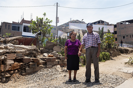 Lima - 19 March, 2018: Hilda Salon Cruz, 77 (left) and Narciso Vargas Huaman, 83 (right) outside their house in Villa Rocio del Triunfo in Lima after having their visual examination at the Taytawasi Senior Center in Villa Maria del Triunfo, Lima. They have been married for more than 50 years. Both of them are losing their vision and Narciso is also losing his hearing. This center for elderly people was open six years ago to provide health care and activities to the community of San Juan de Miraflores and Villa Maria del Triunfo neighborhoods in Lima. Every day dozens of elderly people came here to get together. Periodically, health workers from the near General Hospital Maria Auxiliadora and other Health Centers came here to get talks on eye health and to have vision examinations and send them to operate their eyes in case is necessary.  Other services provided by the center includes general medicine, geriatrics, psychology, physical medicine and rehabilitation, dentistry, gynecology, nutrition, among others.