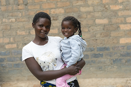 Alice Makofi with daughter Memory Chisenga (3yrs) at their home in ChambeshiVillage, Kapiri Mposhii District, Zambia.  Worldwide, 1 in 5 people are living with hearing loss issues. Nearly 80% of people affected with hearing loss live in low- and middle- income countries where ear and hearing care services are lacking, especially at the community and primary levels. This is largely due to insufficient numbers and unequal distribution of health care professionals and distance from health facilities. If unaddressed, hearing loss has far-reaching consequences such as delayed language development, academic underachievement, social isolation, cognitive decline, higher risk of injuries and increased poverty.   In Zambia, with five ear, nose and throat (ENT) specialists and one audiologist serving a population of 17 million, task-sharing is crucial to address the ear and hearing care needs of the population. With the support of WHO training resources, nurses from 92 health facilities across Zambia have undergone training on ear examination and services. This has not only improved access to these services, but has also helped raise awareness at a primary care level. Over the past two years, more than 15 000 people have been reached with efforts to prevent, identify, and address hearing loss.  Nurse Carol Sinkende lives in Kapiri Mposhi and works at Lukomba rural health center. She is at the forefront of community outreach in Zambia. Sinkende works in a clinic in a remote area overseeing different health topics, which now includes ear and hearing care services after being trained with WHO ear and hearing care resources. She also mentors other community health workers to increase outreach and raise awareness about hearing loss.