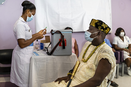 On 2 March 2021, Chief Asafoatse Notey Nii-Ga receives COVID-19 vaccine at Accra's Ridge Hospital, as Ghana rolls out its national COVID-19 vaccination campaign. Health workers, seniors and people with underlying conditions are prioritized for vaccination. As the global rollout of COVAX vaccines accelerates, the first COVID-19 vaccination campaigns in the African Region using COVAX doses began 1 March 2021 in Ghana and Côte D'Ivoire. These campaigns are the among the first to use doses provided by COVAX. This is an historic step towards ensuring equitable distribution of COVID-19 vaccines worldwide. COVAX, the vaccines pillar of the Access to COVID-19 Tools (ACT) Accelerator, is co-led by the Coalition for Epidemic Preparedness Innovations (CEPI), Gavi, the Vaccine Alliance and WHO working in partnership with developed and developing country vaccine manufacturers, UNICEF, the World Bank, and others. It is the only global initiative that is working with governments and manufacturers to ensure COVID-19 vaccines are available worldwide to both higher-income and lower-income countries.