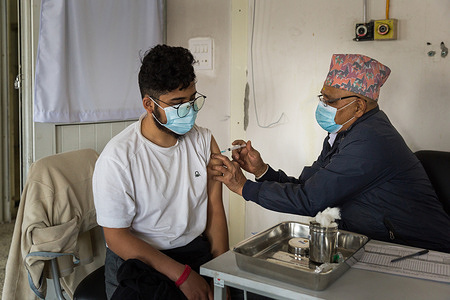 On 11 March 2021, Dr. Suvranta Kc receives COVID-19 vaccine at Paropakar Maternity and Women's Hospital in Kathmandu, Nepal.