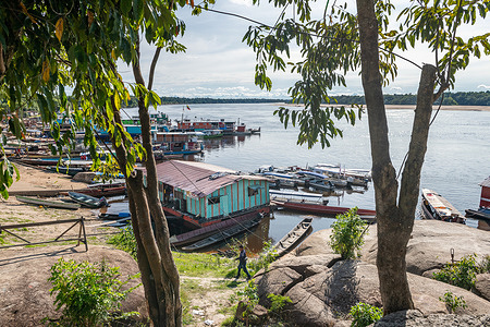 """View of the Inirida River from the port of Puerto Inirida, Colombia,on 15 March 2021. Boats here are used to supply the communities scattered along the long river network that crosses the department of Guainia. The region is located in the Amazon, on the edge of the Guiana Shield, and is mainly composed of primary forest. The department has almost no road network.  InColombia, vulnerable communities in the Amazon region are among the priority groups for COVID-19 vaccination. Colombian authorities are addressing the challenge of reaching out to remote indigenous communities, some of which are only accessible by air or by river. Health teams are going door-to-door and setting up """"pop-up"""" vaccination sites in order to quickly vaccinate as many eligible community residents as possible. Health authorities are adapting their strategy in the area in order to take into account cultural specificities, and are working with indigenous health workers and field vaccinators to facilitate community engagement in the process.   On 1 March 2021, Colombia became the first country in the Americas to receive COVID-19 vaccines through the COVAX Facility, marking an historic step toward the goal of ensuring equitable distribution of COVID-19 vaccines in the region and worldwide. The delivery of 117 000 doses of COVID-19 vaccines adds to the vaccination campaign that the Colombian government started on February 17 with doses obtained from bilateral agreements with the producers.   COVAX, the vaccines pillar of the Access to COVID-19 Tools (ACT) Accelerator, is co-led by the Coalition for Epidemic Preparedness Innovations (CEPI), Gavi, the Vaccine Alliance and WHO, working in partnership with developed and developing country vaccine manufacturers, UNICEF, PAHO Revolving Fund, the World Bank, and others. It is the only global initiative that is working with governments and manufacturers to ensure COVID-19 vaccines are available worldwide to both higher-income and lower-income countries."""