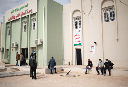 18 March 2021. People wait outside the COVID-19 testing area at Misrata Medical Center, Misrata, Libya.  In response to COVID-19 in Libya, the Ministry of Health has established and equipped a new isolation centre in Misrata.   WHO has supported the COVID-19 response in the country by providing technical guidance and delivering personal protective equipment (PPE) and other COVID-19 supplies.