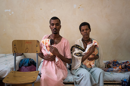 Solomon Minayehu, 32, and his wife Agere Molla, 28, each provide skin-to-skin care to their preterm twins at a KMC unit at Felege Hiwot Hospital in Bahir Dar, Ethiopia on 25 March 2021.  Kangaroo mother care (KMC) is an effective way to prevent mortality in both preterm and low birth weight (LBW) infants. KMC is prolonged skin-to-skin contact for the baby with the mother or other caregiver for as long as possible during day and night, as well as exclusive breastfeeding or breast milk feeding. Fathers and other caregivers can also provide skin to skin care.   Among infants born preterm or LBW, KMC has been shown to reduce infant deaths by as much as 40%, hypothermia by more than 70%, and severe infections by 65%. Mothers remain with their babies from birth to be able to breastfeed and practice skin-to-skin contact as part of KMC.  KMC is one of the most cost-effective ways to increase survival of LBW and preterm newborns in low-income countries like Ethiopia. KMC was first introduced in Ethiopia in 1996 at the Black Lion Hospital. Since then, with support from WHO, KMC services have been expanded to other hospitals and health facilities including the Felege Hiwot Hospital, in Bahir Dar.  Globally, with 15 million babies born preterm (before 37 weeks) and 21 million born LBW (under 2.5kg) each year, these infants face significant health risks, as preterm-related complications are the leading causes of death of newborns. Hence, WHO advises that KMC should continue amid the COVID-19 pandemic. This is due to the proven critical importance of ensuring newborns have close contact with parents after birth, especially for those born LBW or preterm.