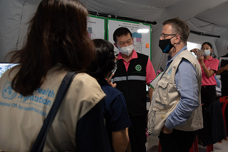 Dr Rick Brown, Programme Manager Health Emergencies and AMR at WHO Thailand, visits Princess Mother National Institute on Drug Abuse Treatment (PMNIDAT) Thanyarak Field Hospital on 19 May 2021.   Thailand was the first country in the WHO South-East Asia Region to get WHO verification for its emergency medical team (EMT) in July 2019. This classification makes Thailand's EMT the 26th in the international roster of WHO classified, internationally deployable medical teams.  To support the COVID-19 response in the country, Thailand's EMT has adapted roles and responsibilities to provide treatment and care at a conventional hospital. The EMT supported the hospital in triage, remote treatment and care, counselling, dispensing medication and hospital referral.  The Princess Mother National Institute on Drug Abuse Treatment established a ward for the care of COVID-19 patients on 10 April 2021, supplying 34 beds for patients in need of respiratory assistance. On 22 April, it created an extended ward to make another 200 beds available and began accepting patients.
